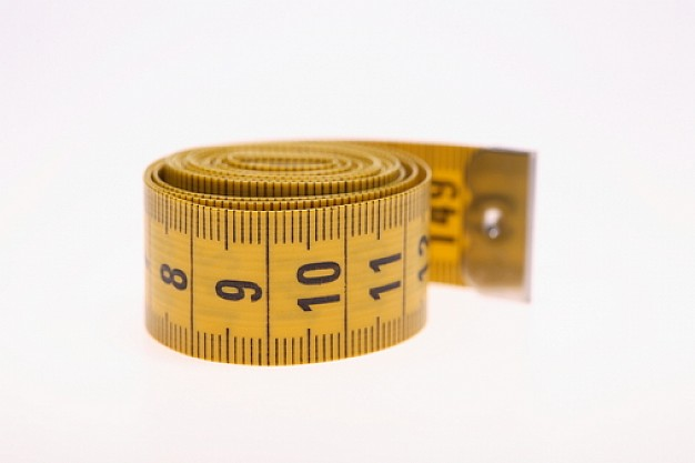 cinta-para-medir-en-espiral-cinta-metrica-amarillo-de-objetos_3113686